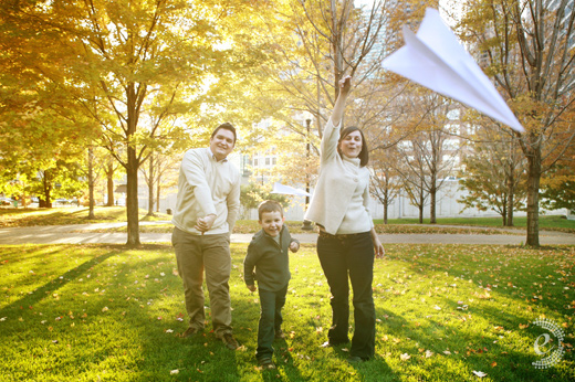 modern fall family portrait paper airplanes